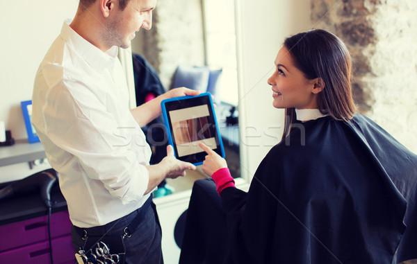 Boldog nő stylist táblagép szalon szépség Stock fotó © dolgachov