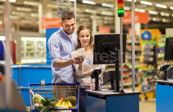 couple buying food at grocery at cash register Stock photo © dolgachov