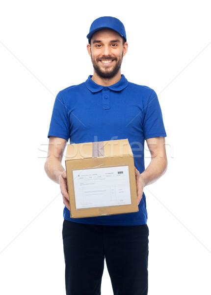 happy delivery man with parcel box Stock photo © dolgachov