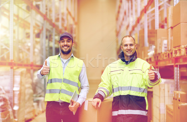men with boxes showing thumbs up at warehouse Stock photo © dolgachov