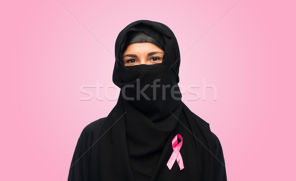 muslim woman with breast cancer awareness ribbon Stock photo © dolgachov