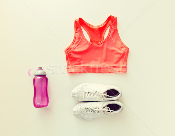 close up of female sports clothing and bottle set Stock photo © dolgachov