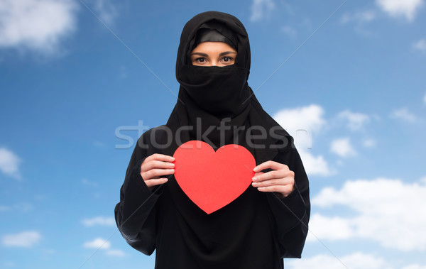 muslim woman in hijab holding red heart Stock photo © dolgachov
