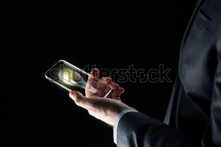 businessman with lightbulb on smartphone Stock photo © dolgachov