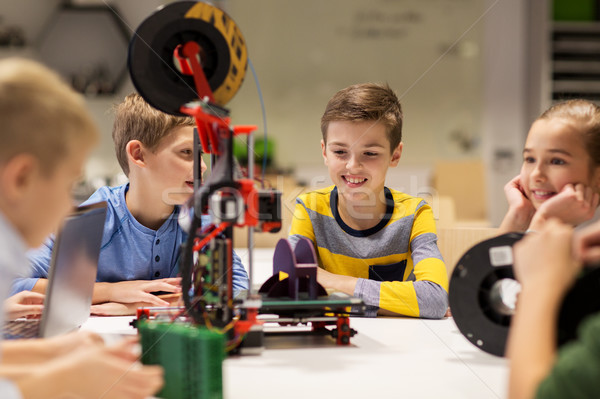 happy children with 3d printer at robotics school Stock photo © dolgachov