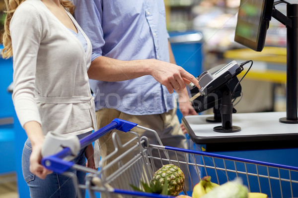 couple buying food at grocery self-checkout Stock photo © dolgachov