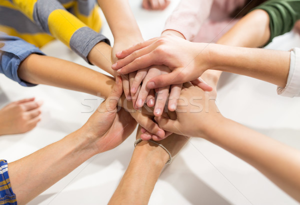 group of kinds with hands on top Stock photo © dolgachov