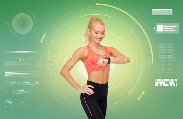 smiling woman with fitness tracker or smartwatch Stock photo © dolgachov