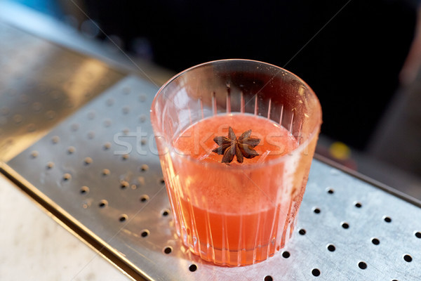 glass of cocktail with anise at bar Stock photo © dolgachov