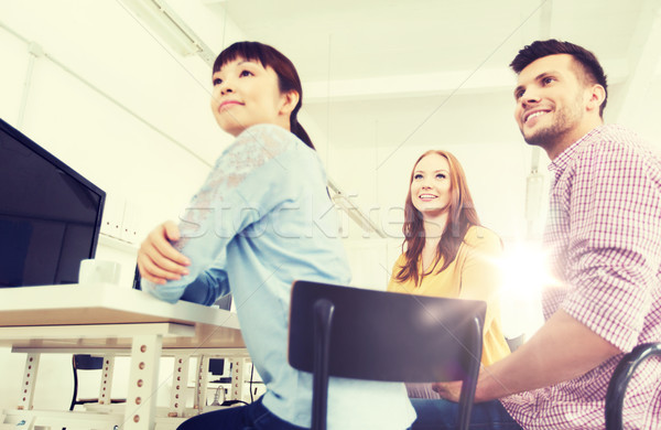 happy creative team drinking coffee at office Stock photo © dolgachov