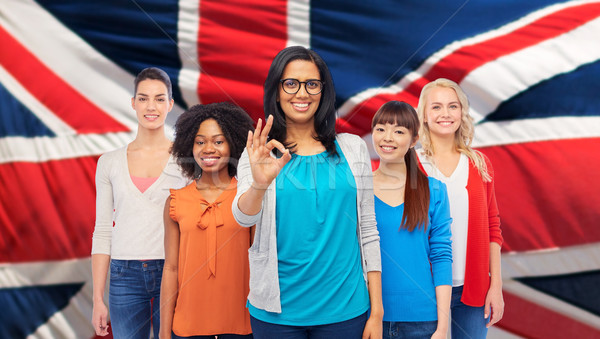 Nemzetközi angol boldog nők mutat ok Stock fotó © dolgachov