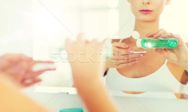 Mulher jovem loção lavagem cara banheiro beleza Foto stock © dolgachov