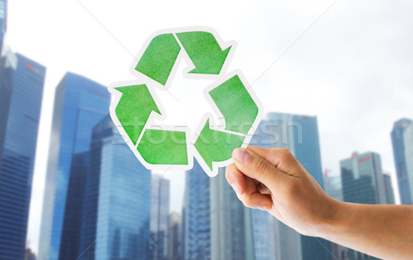 close up of hand with green recycle sign in city Stock photo © dolgachov