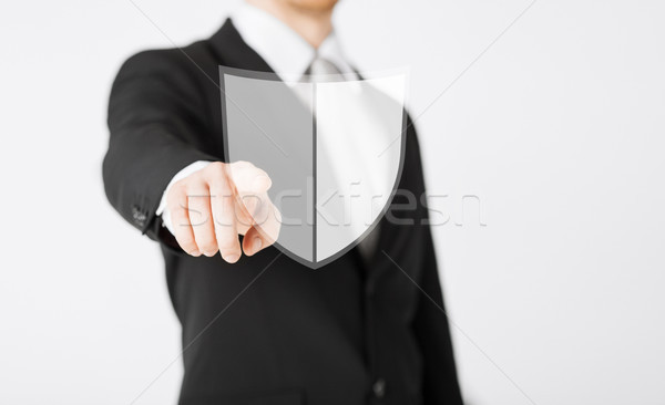 man pointing finger at antivirus program icon Stock photo © dolgachov