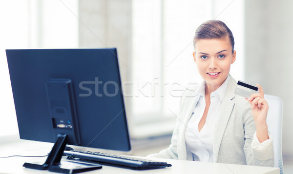 businesswoman with computer using credit card Stock photo © dolgachov