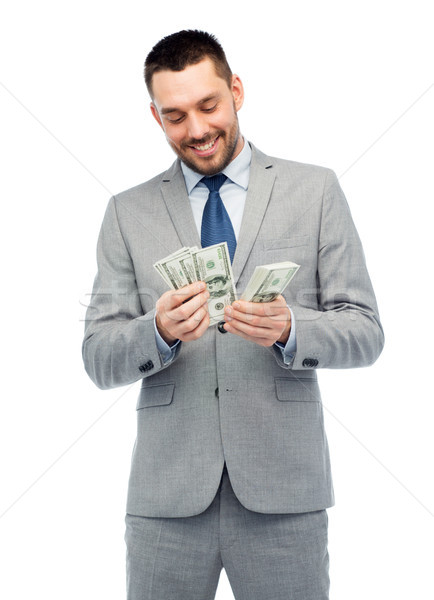 Stock photo: smiling businessman counting american dollar money