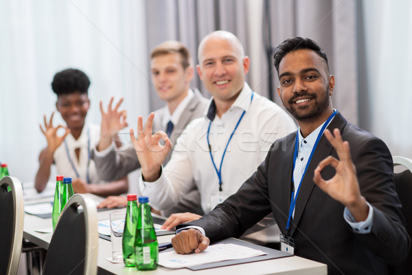 people at business conference showing ok hand sign Stock photo © dolgachov
