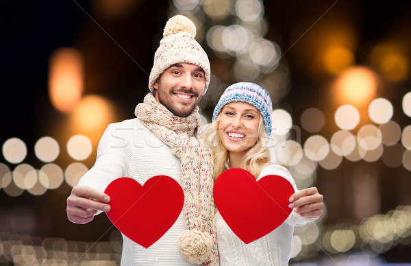 couple with red hearts over christmas lights Stock photo © dolgachov