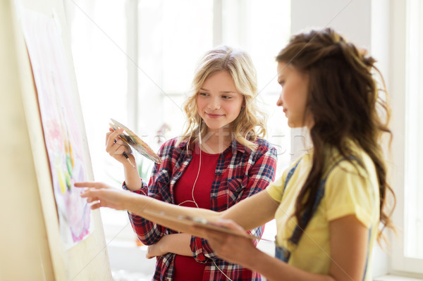 student girls or artists painting at art school Stock photo © dolgachov