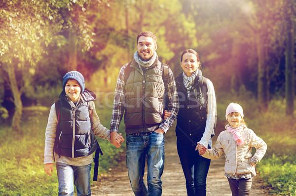 happy family with backpacks hiking Stock photo © dolgachov