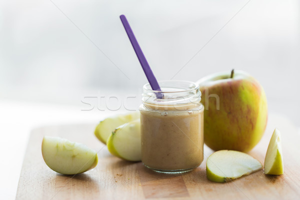 jar with apple fruit puree or baby food on table Stock photo © dolgachov
