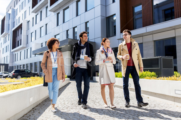 people with coffee and conference badges in city Stock photo © dolgachov
