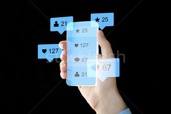 Kéz közösségi média ikonok okostelefon modern technológia Stock fotó © dolgachov