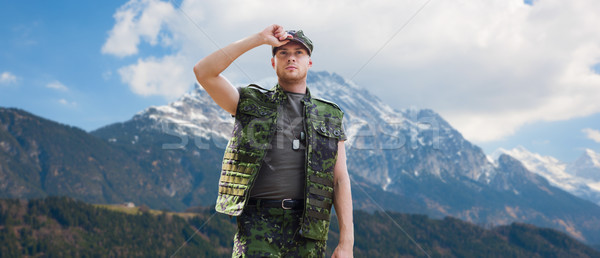 soldier in military uniform over mountains Stock photo © dolgachov