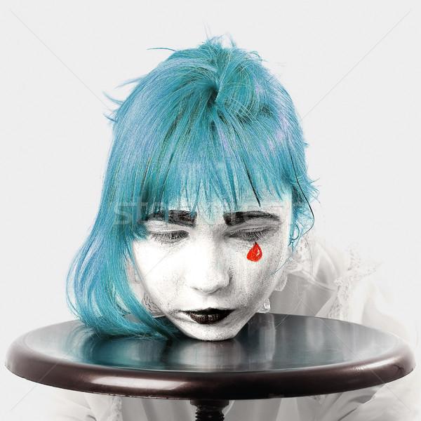 Kırmızı gözyaşı palyaço makyaj kız mavi Stok fotoğraf © dolgachov