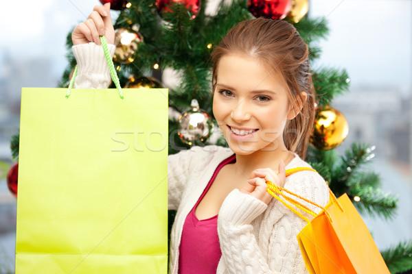 Boldog nő bevásárlótáskák karácsonyfa fényes kép Stock fotó © dolgachov