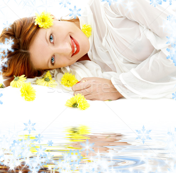 beauty with yellow flowers on white sand Stock photo © dolgachov
