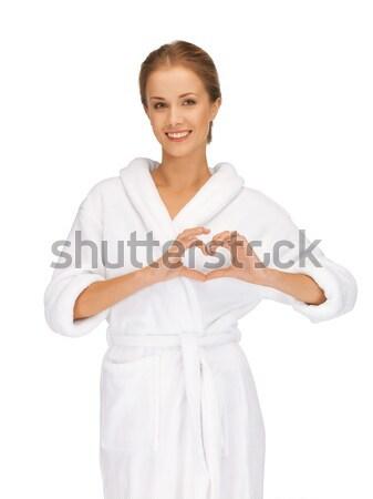 beatiful woman with heart shaped hands Stock photo © dolgachov