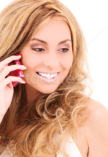 Gelukkig vrouw mobiele telefoon foto telefoon mobiele Stockfoto © dolgachov