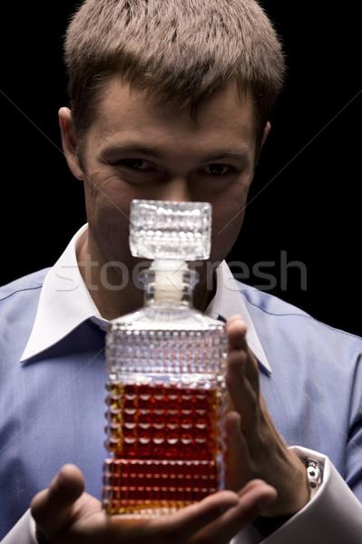 Man fles donkere foto zwarte shirt Stockfoto © dolgachov