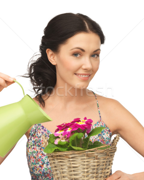 housewife with flower in basket and watering can Stock photo © dolgachov