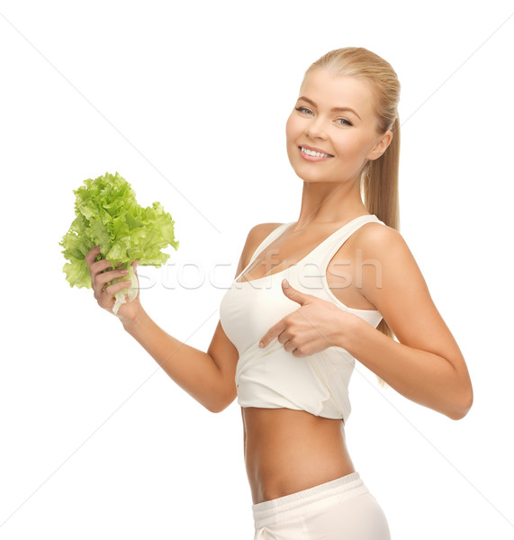 sporty woman with lettuce showing abs Stock photo © dolgachov