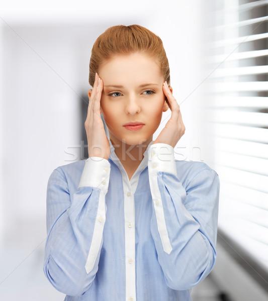 Hangsúlyos nő tart fej kezek iroda Stock fotó © dolgachov