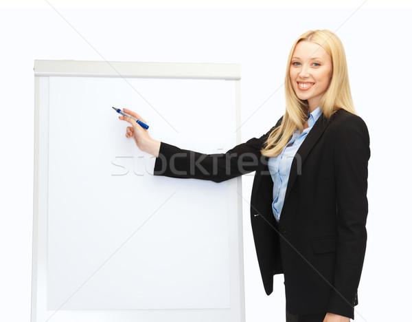 Empresária escrita flipchart escritório educação mulher Foto stock © dolgachov