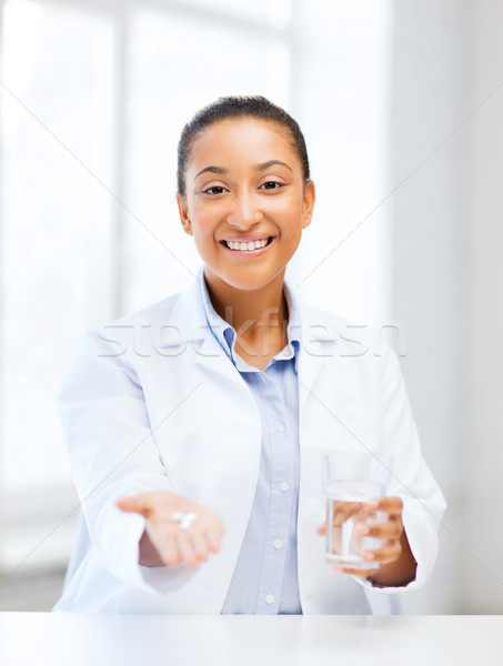 doctor with offering pills Stock photo © dolgachov