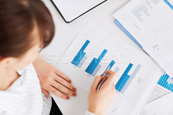 woman hand with charts and papers Stock photo © dolgachov