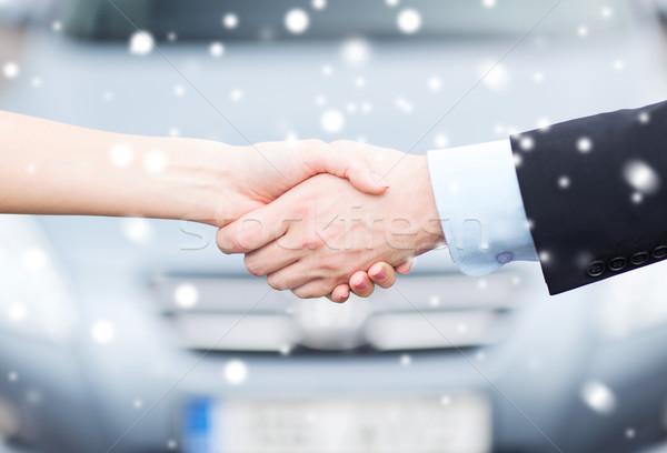 customer and salesman shaking hands Stock photo © dolgachov