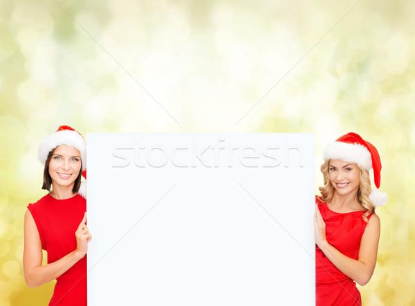 Kadın yardımcı beyaz tahta Noel Stok fotoğraf © dolgachov