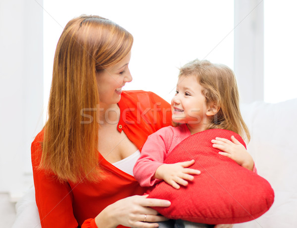 happy mother and child with big red heart at home Stock photo © dolgachov
