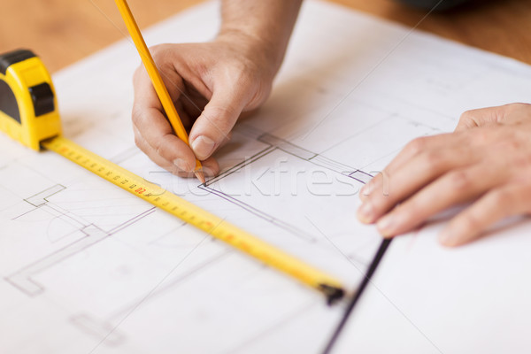 close up of male hands making changes to blueprint Stock photo © dolgachov