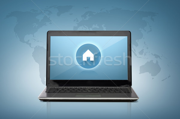 laptop computer with house button on screen Stock photo © dolgachov