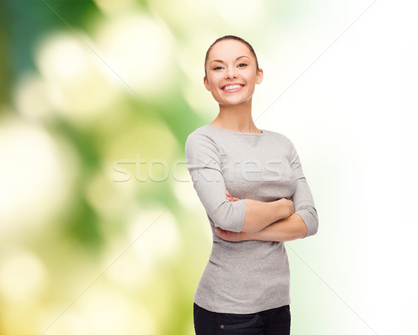 smiling asian woman over with crossed arms Stock photo © dolgachov