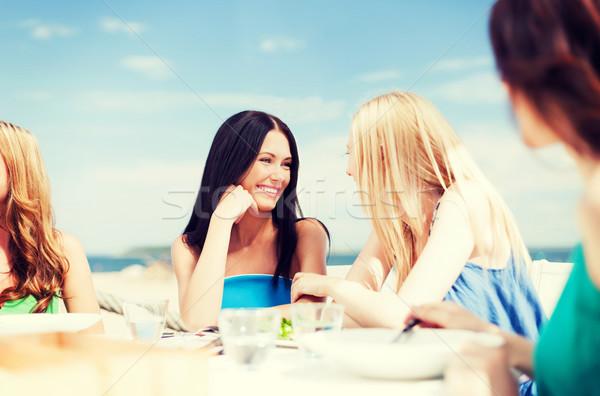 Meisjes cafe strand zomer vakantie vakantie Stockfoto © dolgachov
