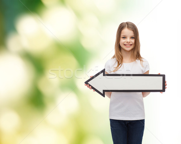 smiling girl with blank arrow pointing left Stock photo © dolgachov