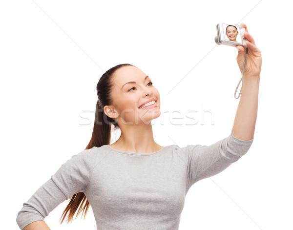smiling asian woman with digital camera Stock photo © dolgachov