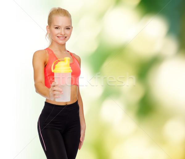 Mosolyog sportos nő fehérje shake üveg Stock fotó © dolgachov